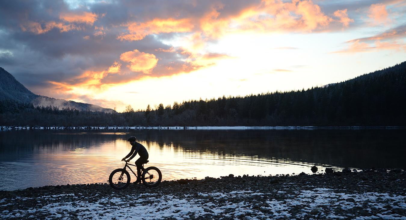 fat bike silhouette on lake reduced