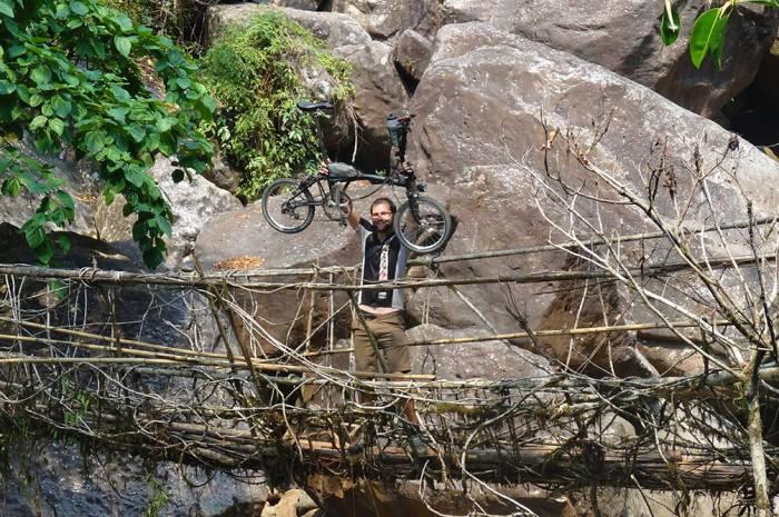 Crossing a vine bridge in Cherrapunji, India