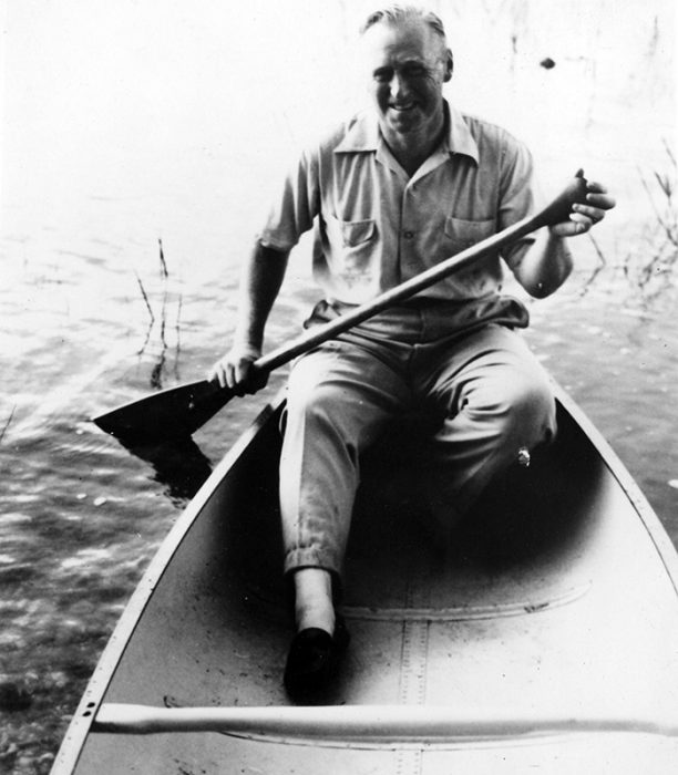 Leroy Grumman tests out his trademark aluminum canoe. Photograph courtesy of the San Diego Air and Space Museum