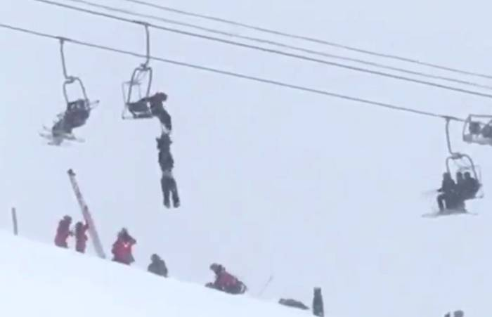 skier-hanging-from-chairlift