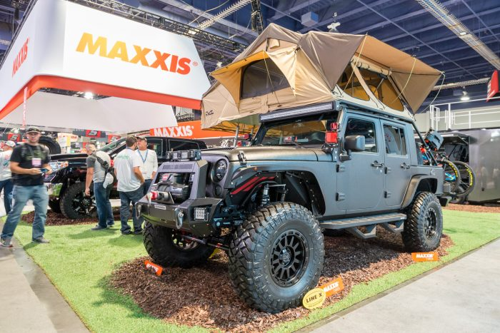 jeep wrangler with a rooftop tent at sema show