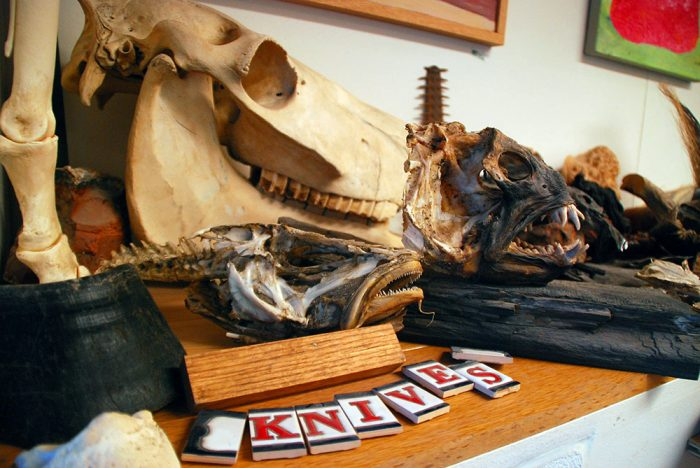 skulls in a knife workshop