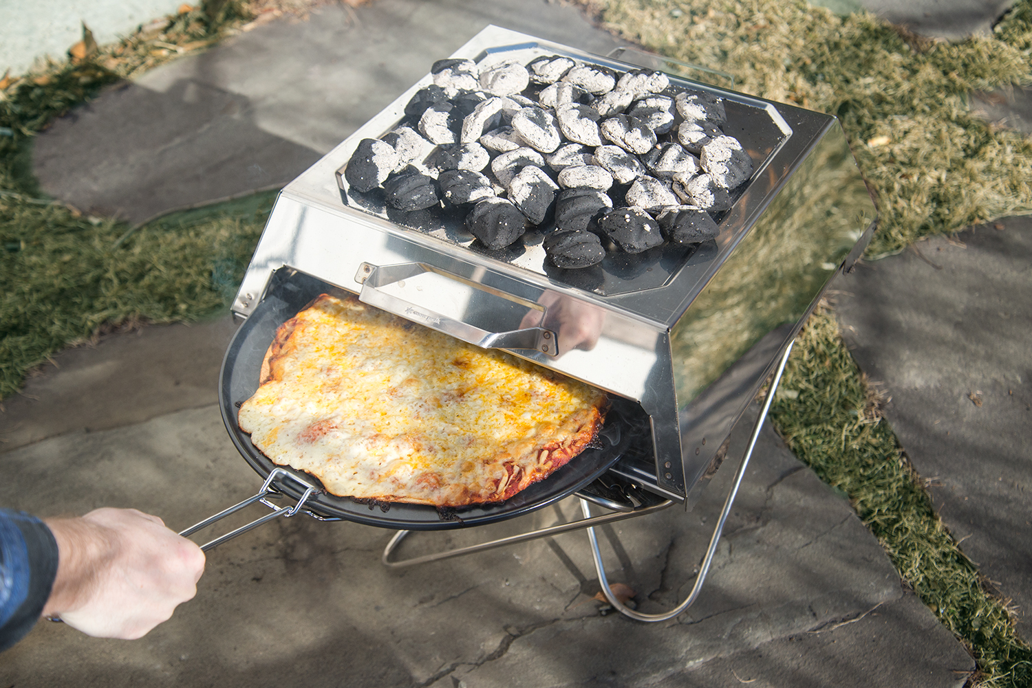 pizza oven snowpeak - First Look: Stove Cooks Pizza With Your Campfire