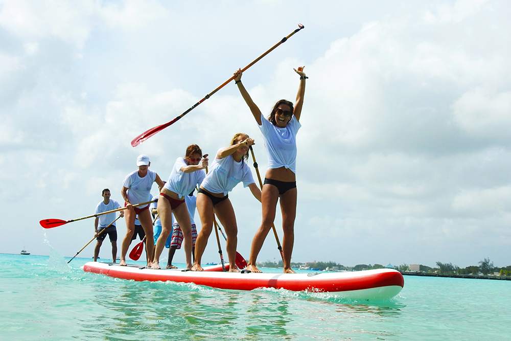 red paddle 4-person sup cheering