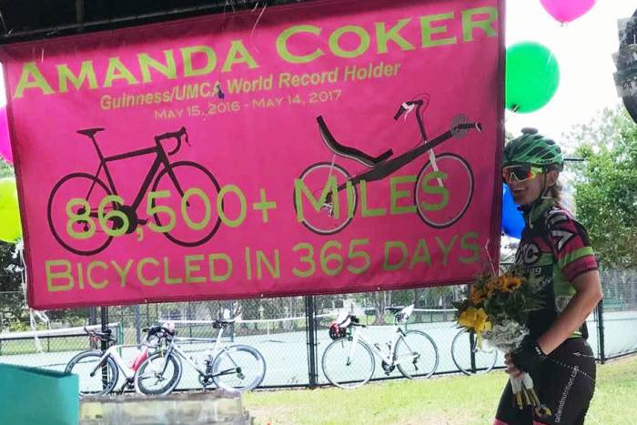 Most miles biked in a year amanda coker sets record