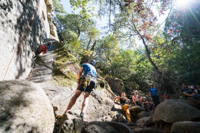 Adults learning to climb at the Camelbak Pursuit Series summer camp