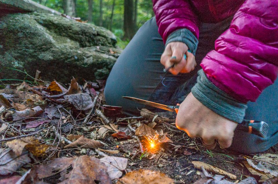 Starting a fire with Bear Grylls using a striker