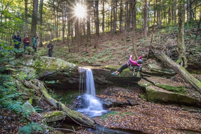 Writer Mallory Paige on a tyrolean traverse at survival academy
