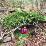 Writer Mallory Paige builds a survival shelter at Bear Grylls Survival Academy