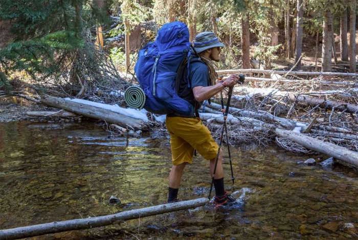 The author crosses a stream in the waterproof boots