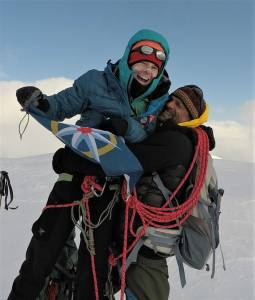 Pascale Marceau and Lonnei Dupre embrace at the summit of Jeanette Peak