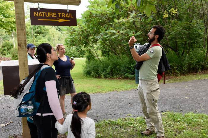 Camp Ambassador guides a nature hike through New York park