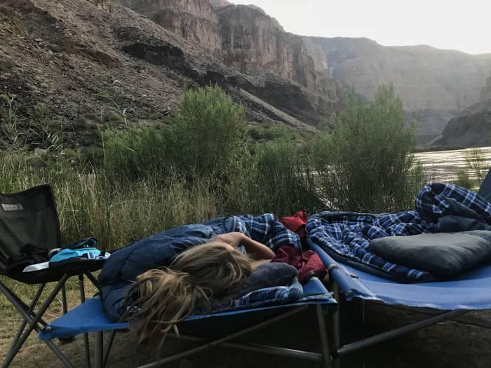sleeping in a cot along the colorado river