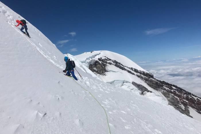 Sam and Erik slog through snow on Emmons Glacier