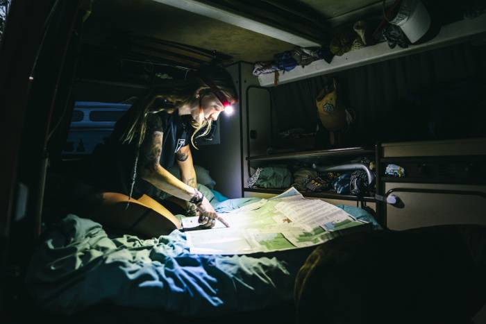 Woman illuminating map with the BioLite Headlamp 330
