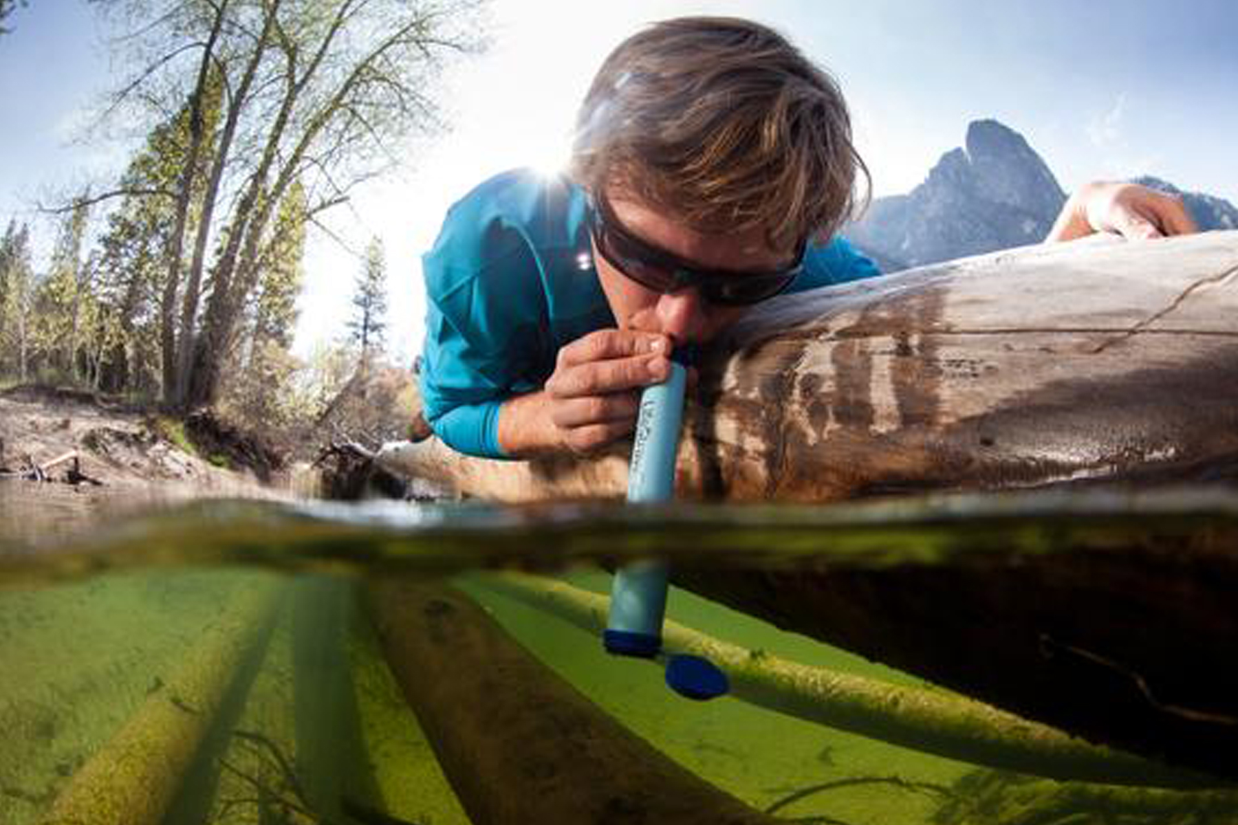 Man drinking from water with LifeStraw