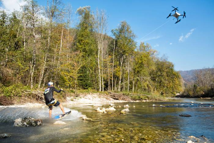 New Sport? Drone Tugs Wakeskater Across Pristine Shallow River
