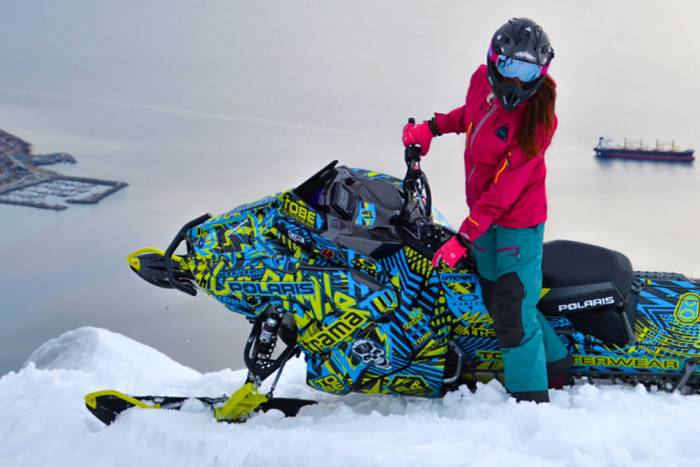 Woman on TOBE Outerwear snowmobile