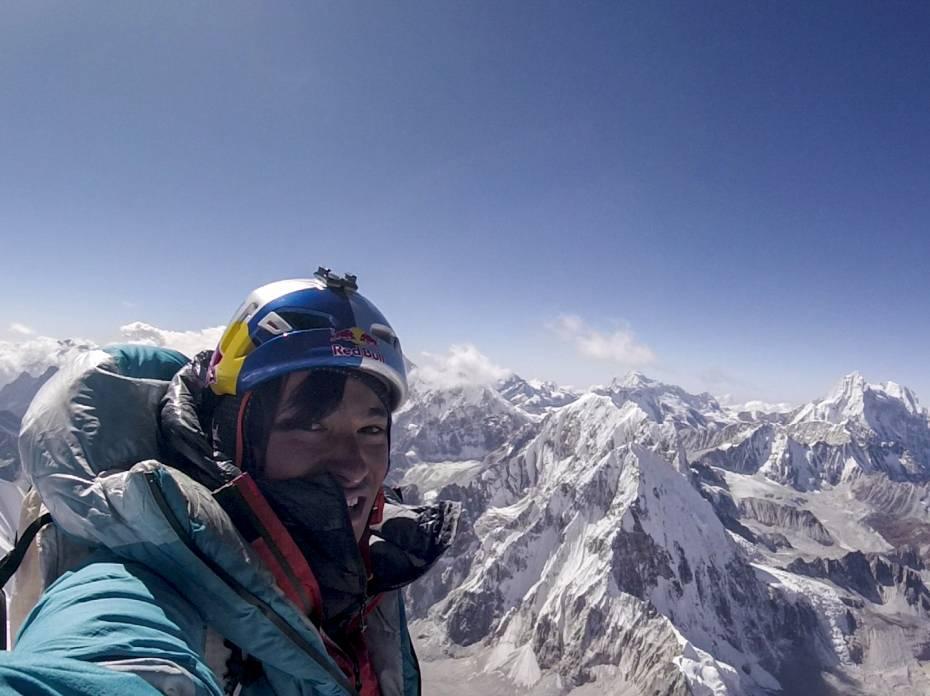 david lama on the summit of lunag ri