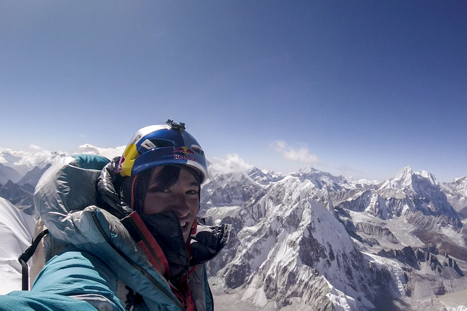 david lama on the summit of lunag ri
