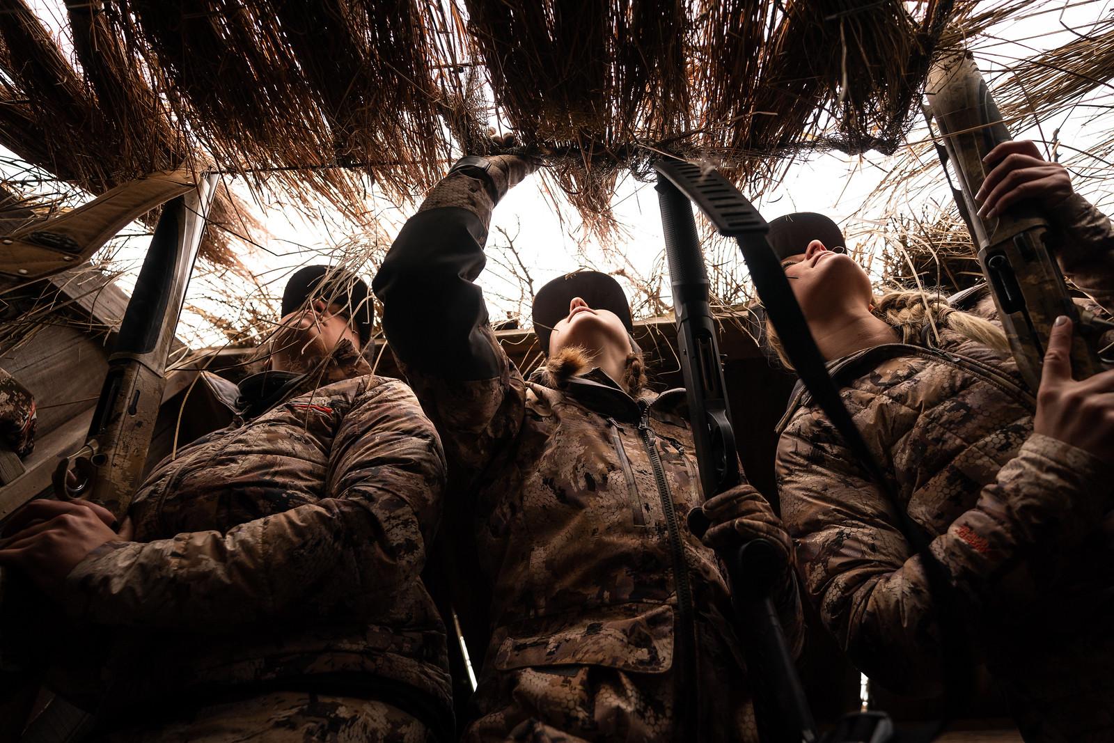 3 hunters wearing same brown camo in deer stand