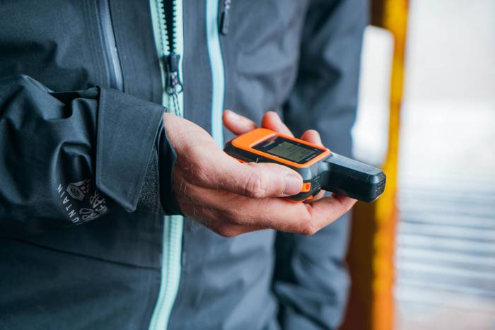 holding garmin inreach mini satellite gps communicator