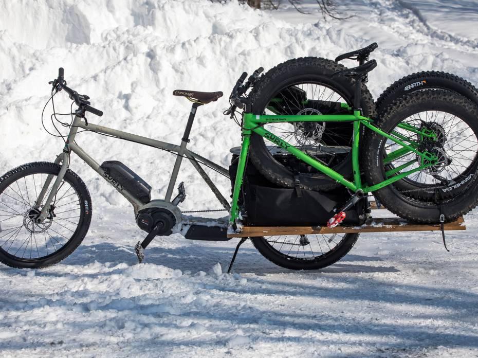 surly big easy e-cargo bike towing fat bikes