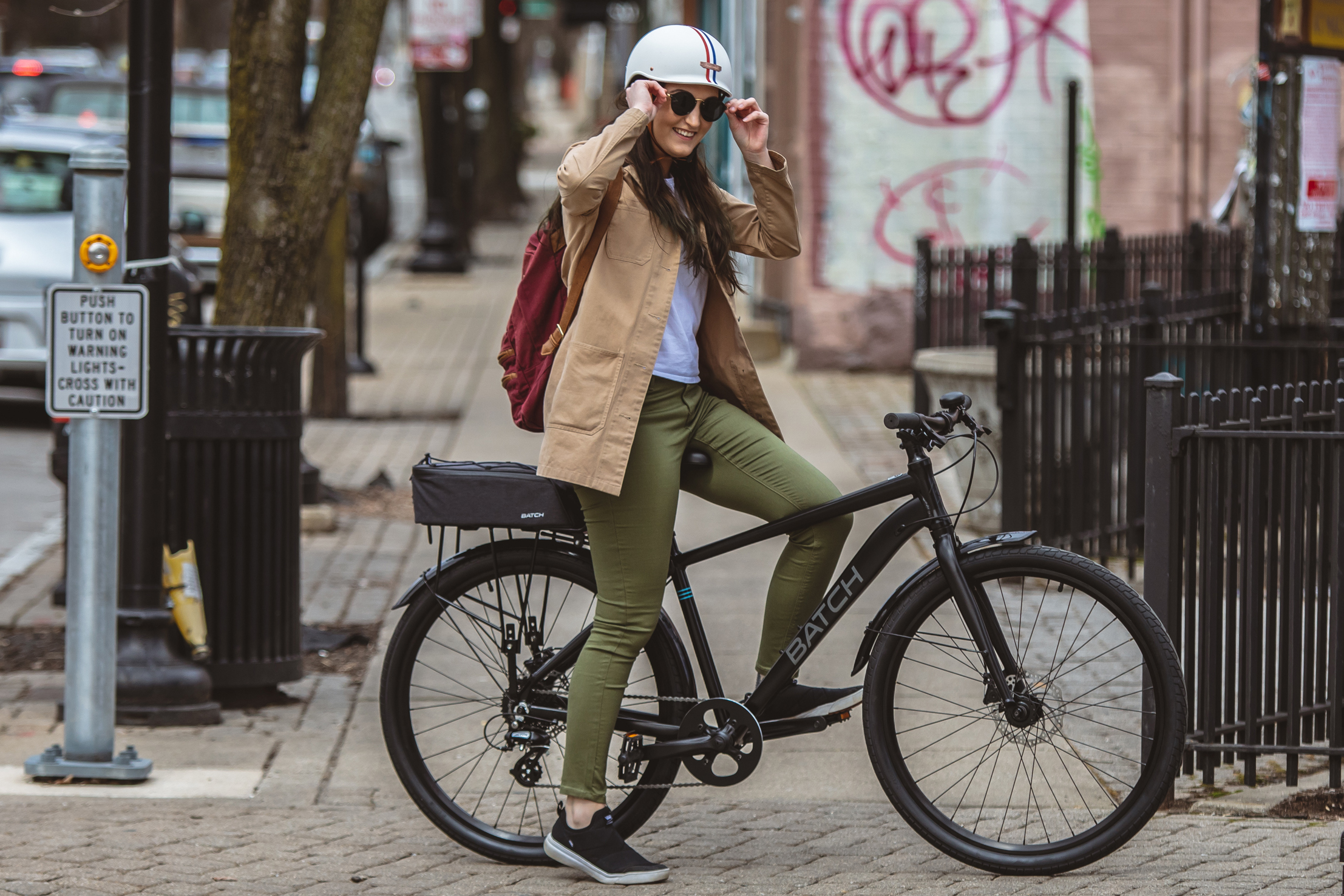 Woman posing on Batch Commuter bike