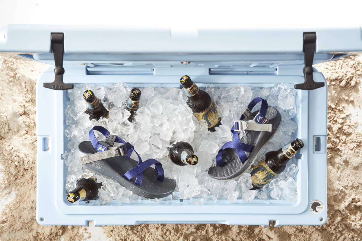 Beer and Chaco sandals in an ice-filled cooler
