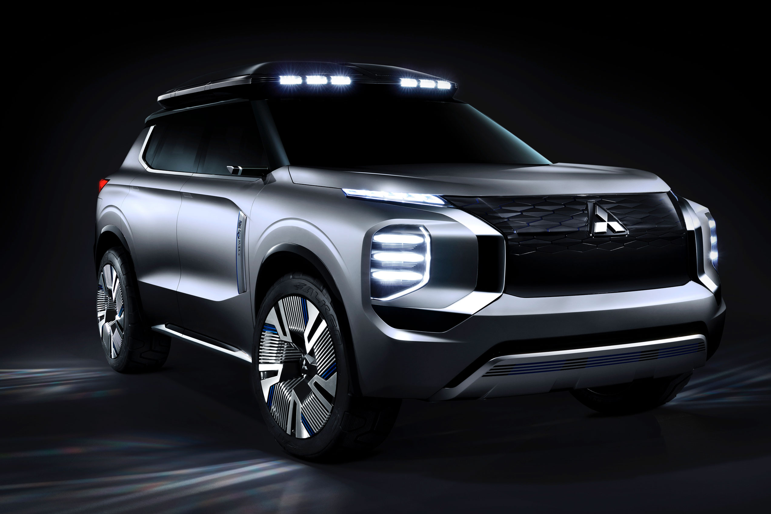 Mitsubishi Engleberg Tourer concept hybrid SUV headlights in the dark