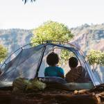 couple-camping-in-tent-rei-dividend