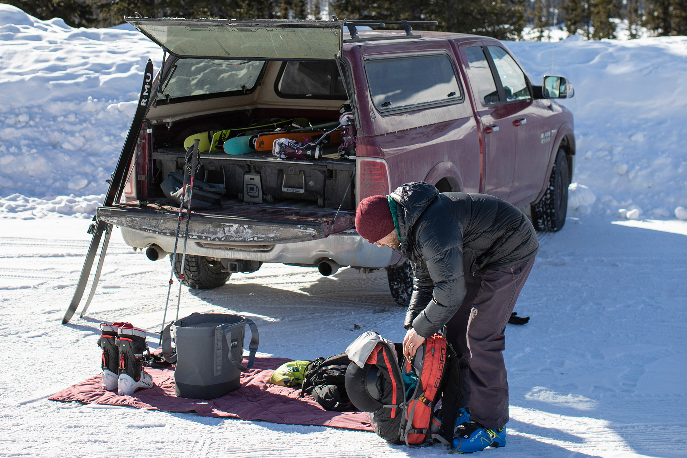 Camper laying out his gear on the YETI Lowlands Blanket