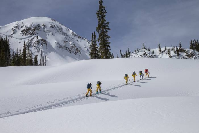 Six skiers wearing The North Face FUTURELIGHT, skinning uphill