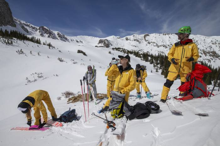 Skiers wearing The North Face FUTURELIGHT taking a rest