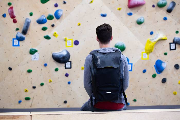 Climber wearing Trango City Sender climbing pack in gym