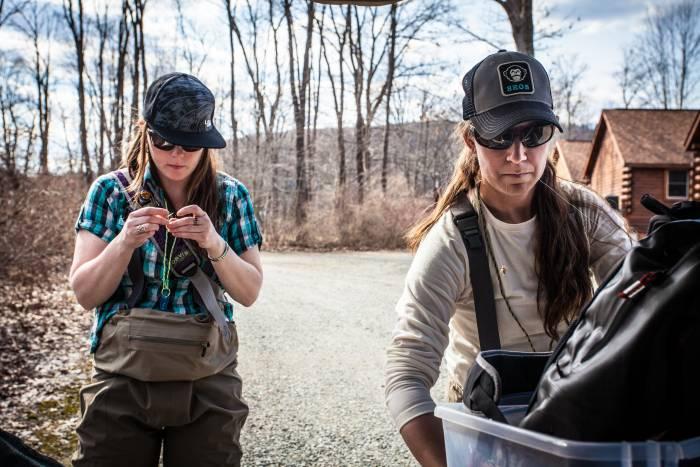 Two women wearing fishing waders