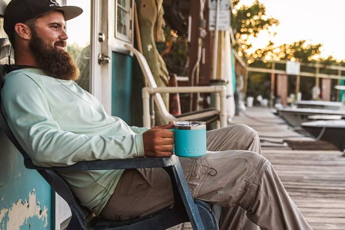 Man using YETI Reef Blue Rambler Mug