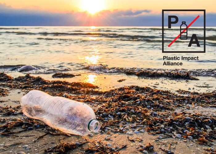 Plastic Impact Alliance water bottle on beach