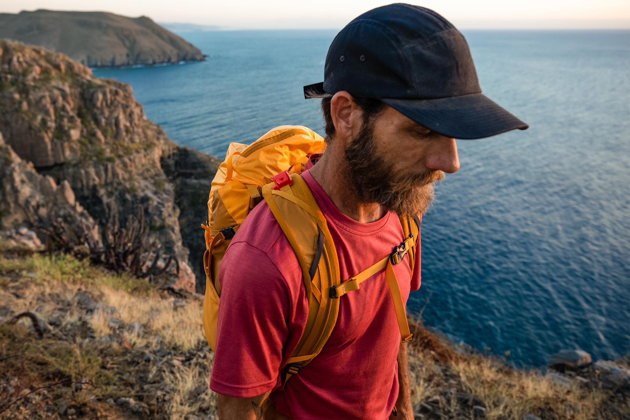 Man hiking wearing Smartwool sport collection sweat-mapping Tech Tee