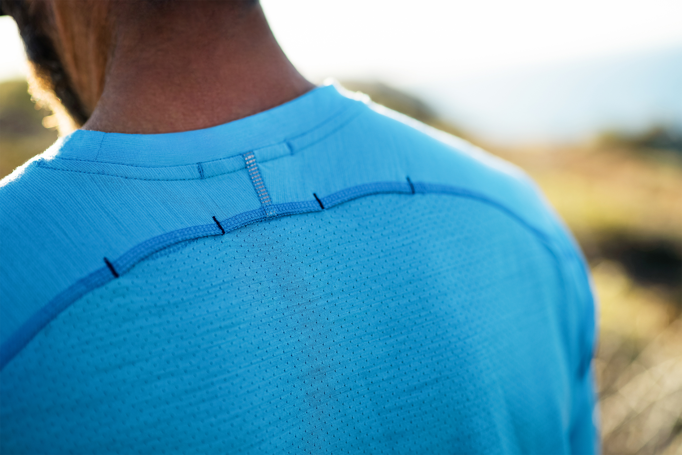 Man wearing Smartwool sport collection sweat-mapping Tech Tee