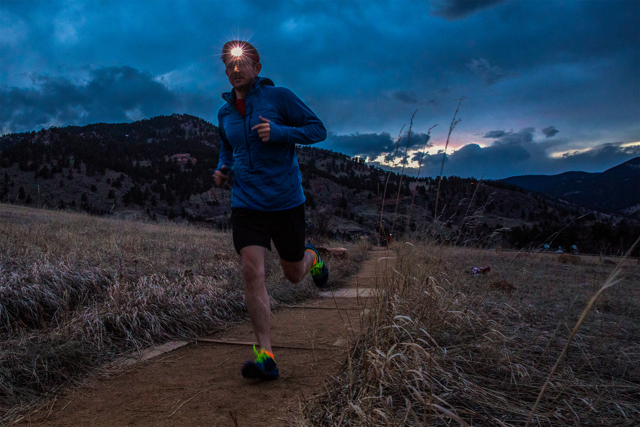 Trail runner wearing the BioLite Headlamp 330