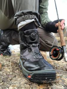 Korkers DarkHorse boot closeup next to rod and reel