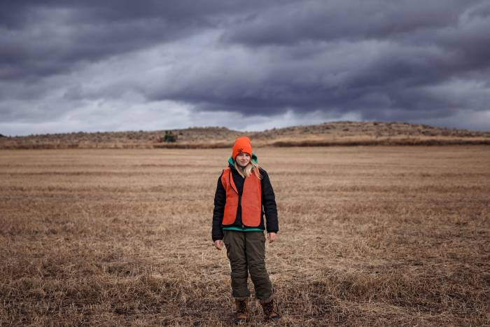 12-year-old hunter in a field