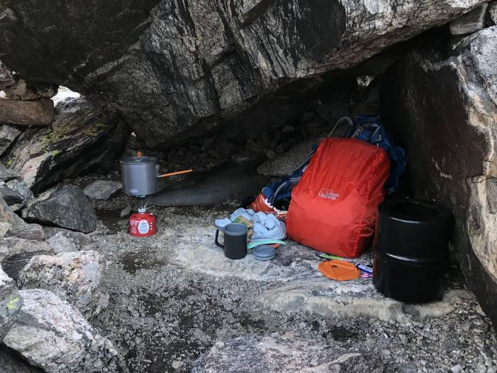 camp cooking in a rock cave