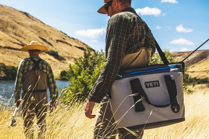 Fly FIsherman Carrying YETI Hopper Two Soft Cooler
