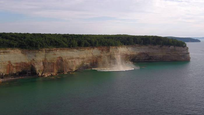 Close Call: Kayakers Nearly Crushed by Cliff Collapse