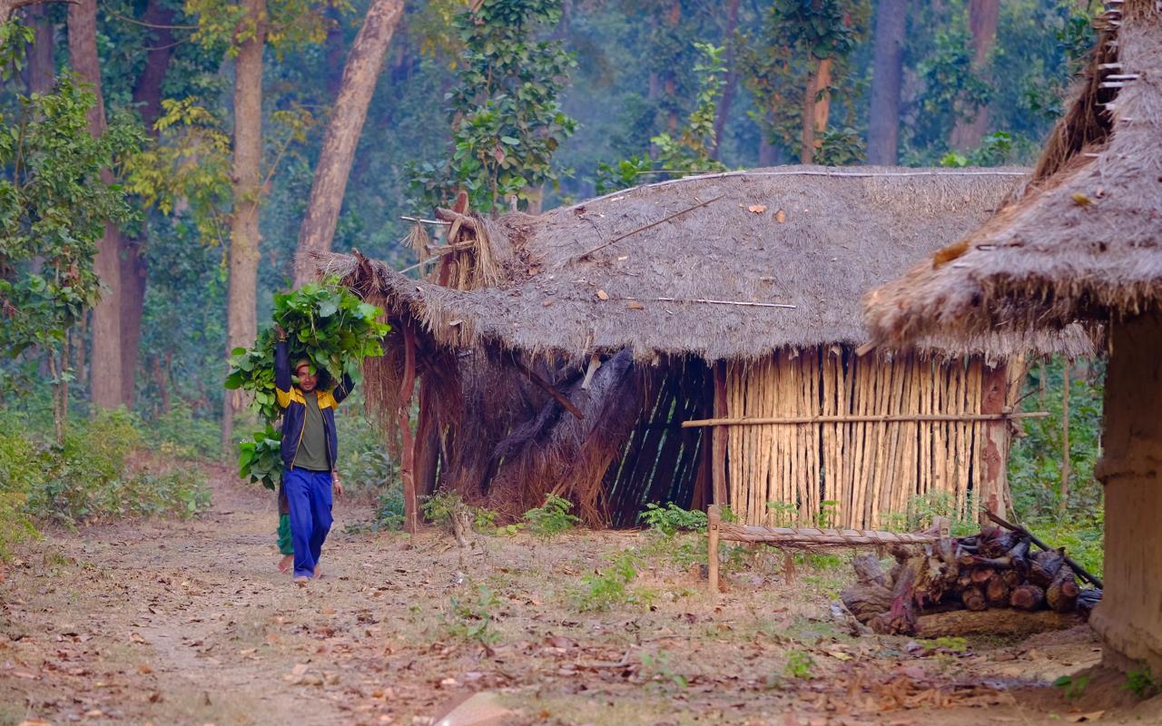 man walking through makeshift refugee village in Nepal