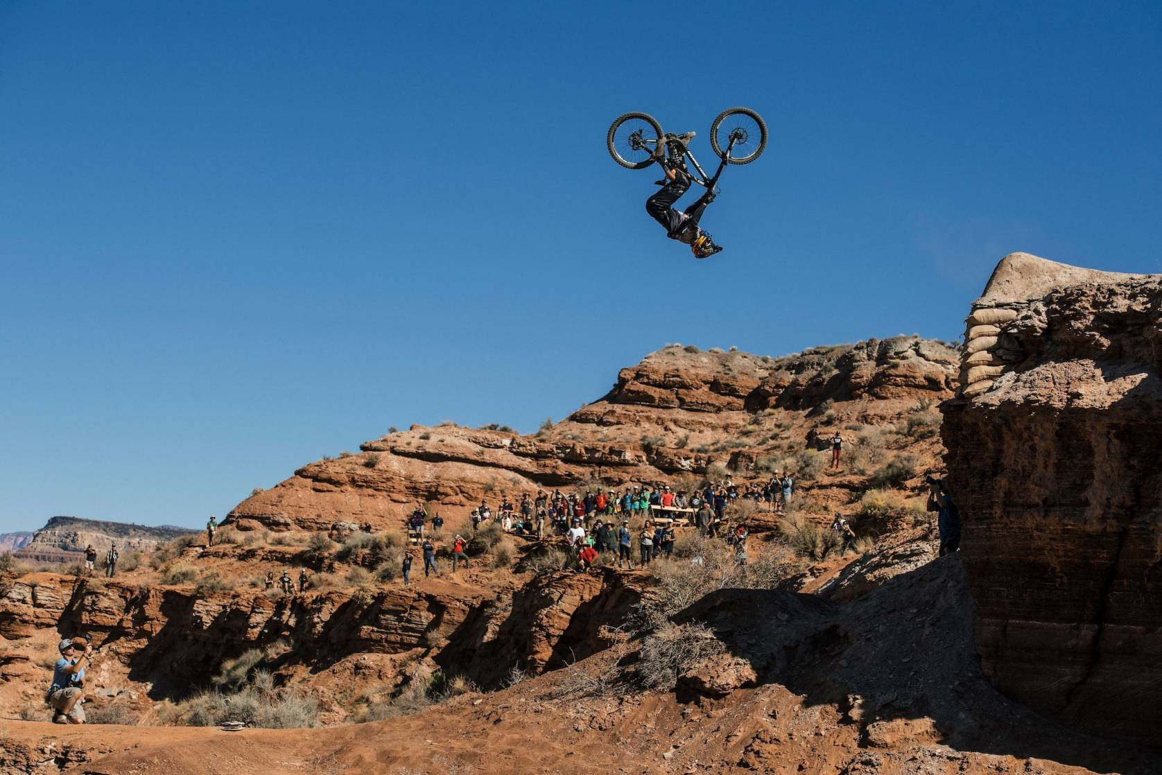 man doing backflip on bike midair in Utah