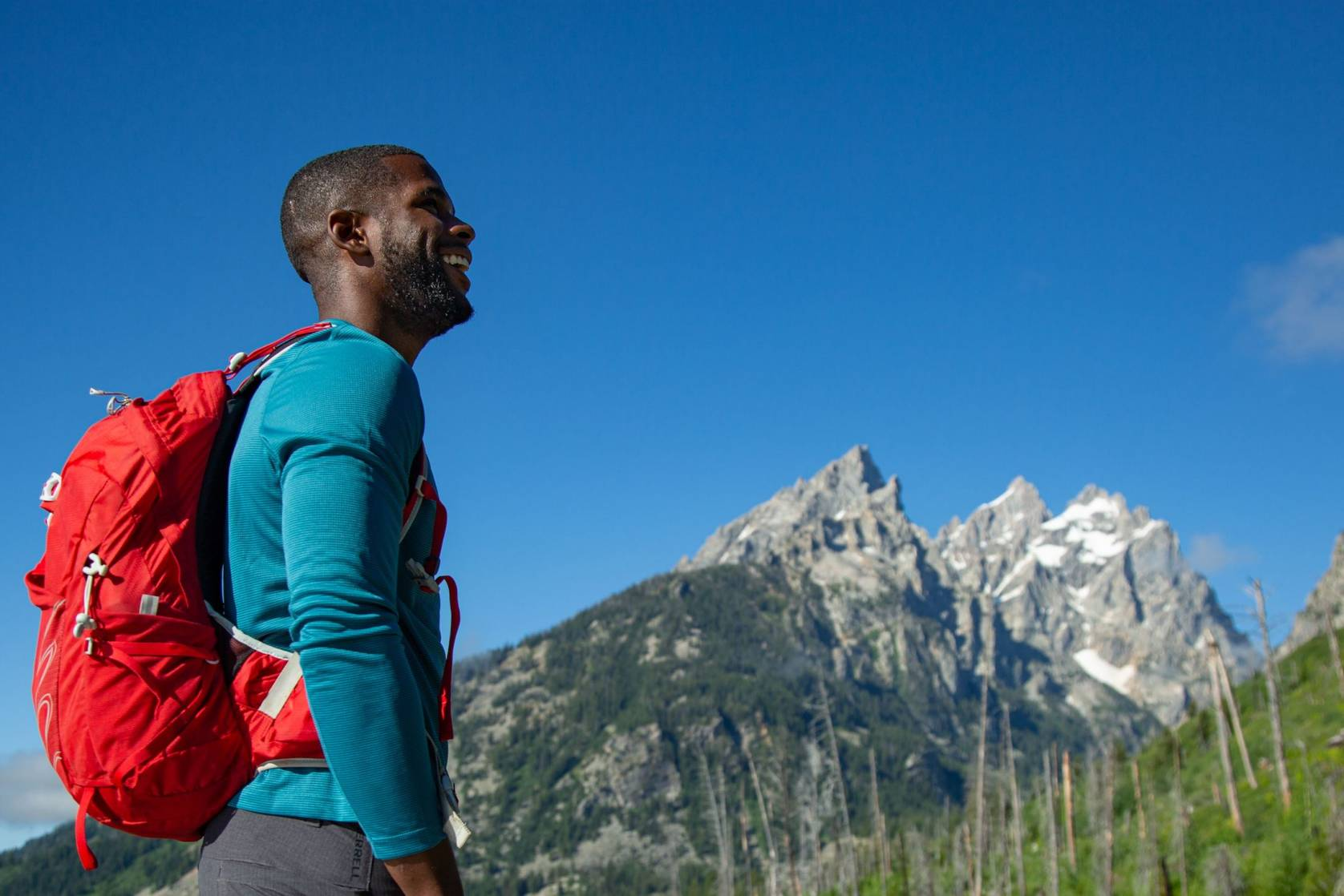 African American hiker Tyrhee Moore looking up towards mountains