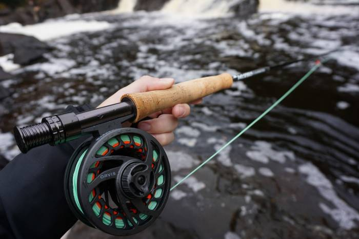 Holding Orvis Clearwater Fly Fishing Rod and Reel